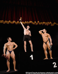 Funny photo of a group of three body building champions with thier trophys. The top guy has the smallest trophy and is a skinny little wimpy dude. The second and third place winners can't believe he beat them. Weight lifters wearing thongs.